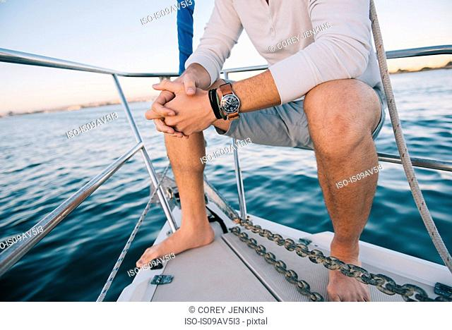 Man enjoying view on sailboat, San Diego Bay, California, USA