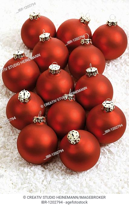 Red Christmas balls on artificial snow