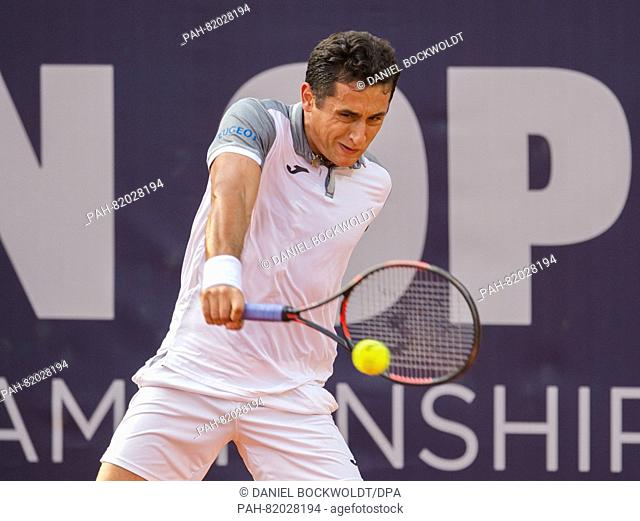Nicolas Almagro from Spain plays against Paul-Henri Mathieu from France in the second round of the German Tennis Championships at the tennis stadium Am...