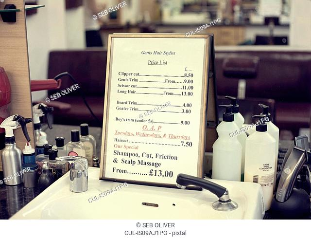 Price list in barbershop, close up