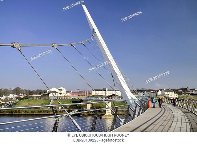 The Peace Bridge over the River Foyle opened in 2011 with the former Ebrington Barracks in the background