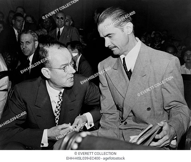 Howard Hughes (right), before testifying to the Senate War Investigating subcommittee. At left is his attorney, Thomas Black