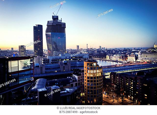 Office buildings and residential buildings at dusk. Bankside, London, England