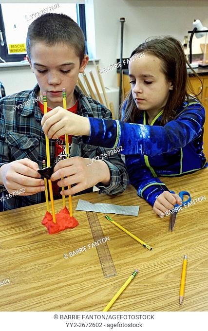 Middle School Girls Working on Science Experiment, Wellsville, New York, USA