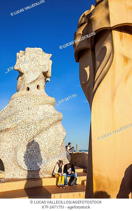 Tourists, rooftop Chimneys in Casa Mila, La Pedrera, Barcelona, Catalonia, Spain