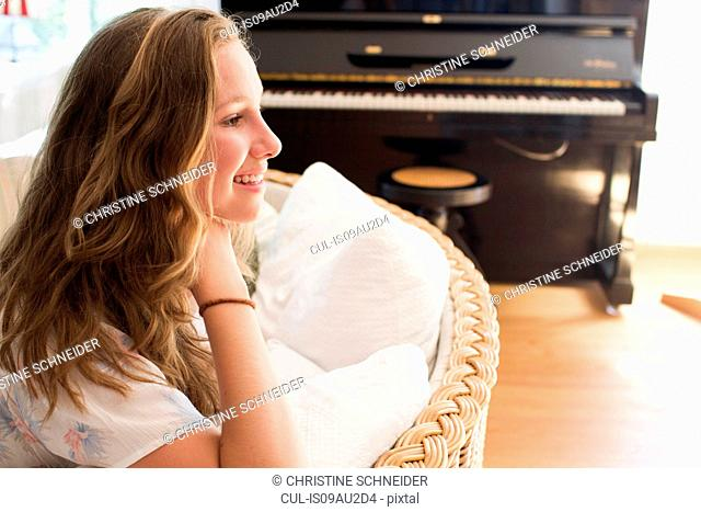 Portrait of pretty teenage girl in sitting room