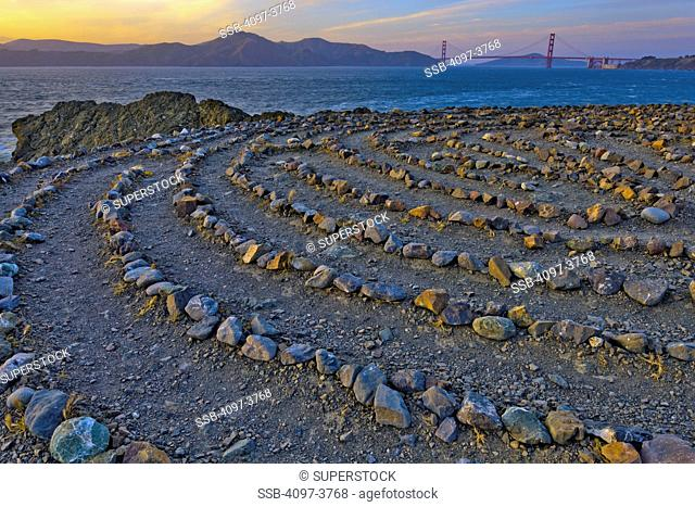 Stone labyrinth with Golden Gate Bridge in the background, Lands End, San Francisco, California, USA