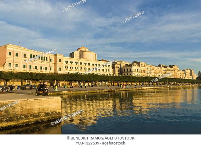 View of Ortygia Island seafront bathed in evening sunlight, Siracusa, Sicily, Italy