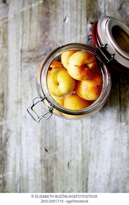 Picture about some apricots in a glass jar