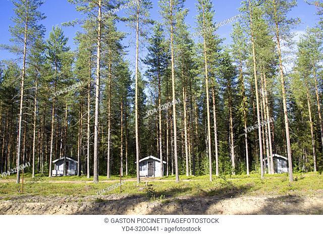Wooden cabins in the snowy desert, Riksgransen, border between Norway and Sweden
