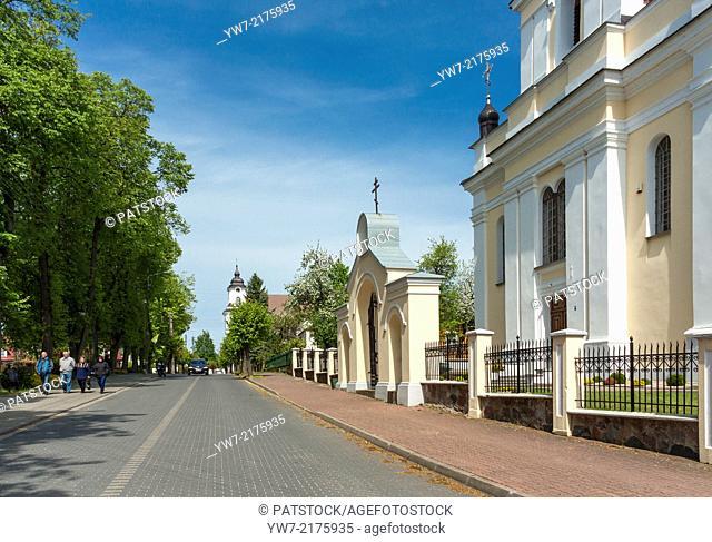 Tourists walk by the St. Nicolas Orthodox church in Drohiczyn, Poland