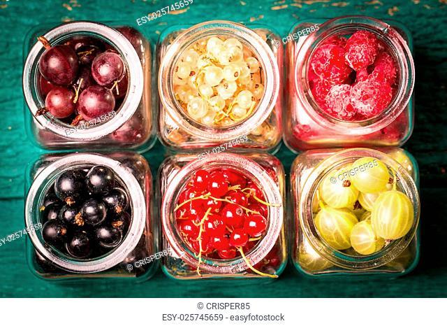 Fresh summer berries , wooden background, healthy food