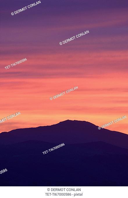 USA, Colorado, Denver, Mountain range with colorful sky at dusk