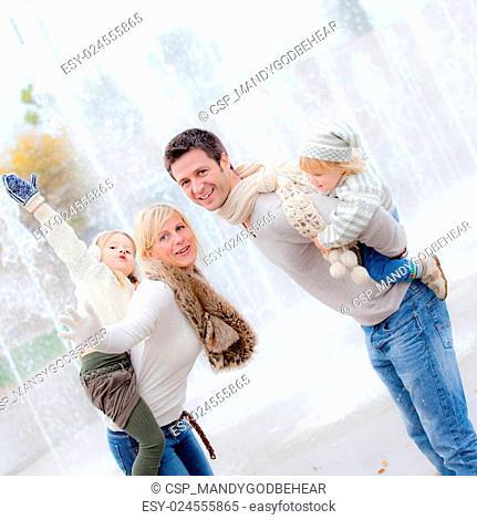 smiling piggyback family