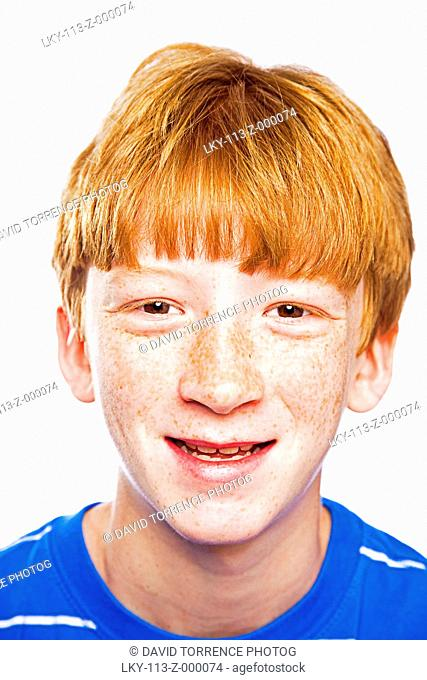 Portrait of young red haired boy