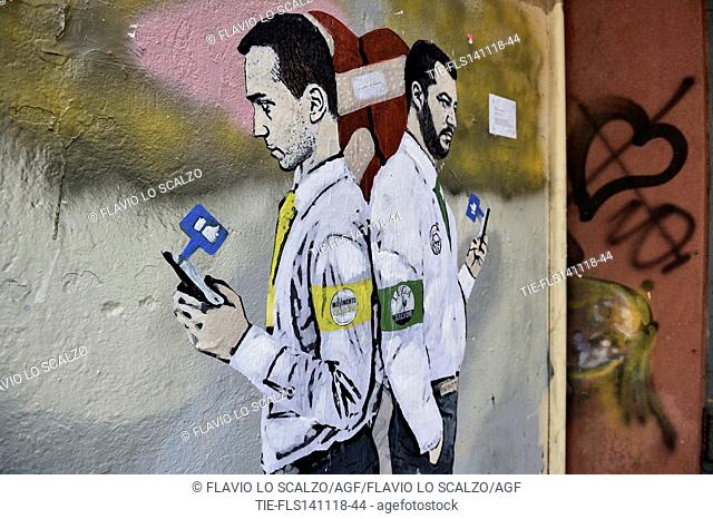Murales by the street artist TvBoy, depicting the Italian Deputy Prime Minister and Minister of Economic Development Luigi Di Maio and the Italian Deputy Prime...