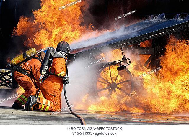Firemen putting out fire on airplane. Copenhagen. Denmark