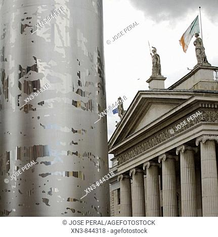 The Spike on O'Connell Street, backgroundIrish flag on top of the GPO Building ,Dublin, Ireland
