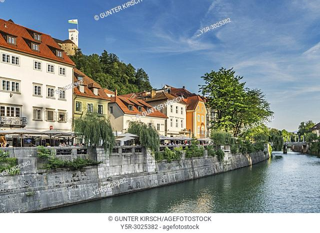 View from the old town of Ljubljana over the river Ljubljanica to the castle of Ljubljana. The Ljubljana Castle is a powerful medieval fortress and the symbol...