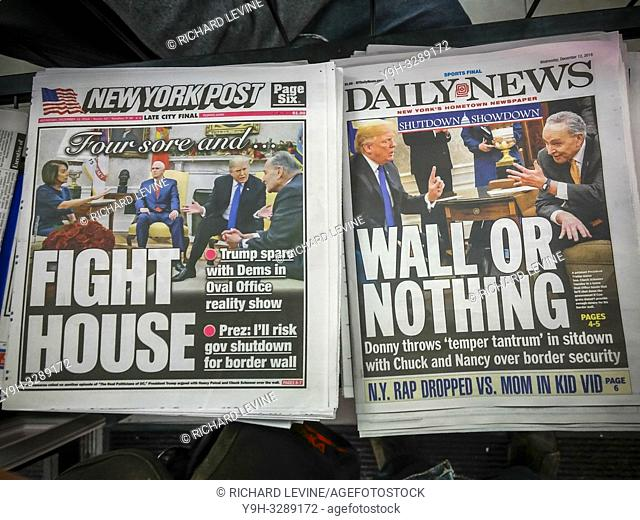 New York, NY/USA- December 12, 2018 Headlines of New York newspapers on Wednesday, December 12, 2018 report on the previous days' contentious meeting between US...