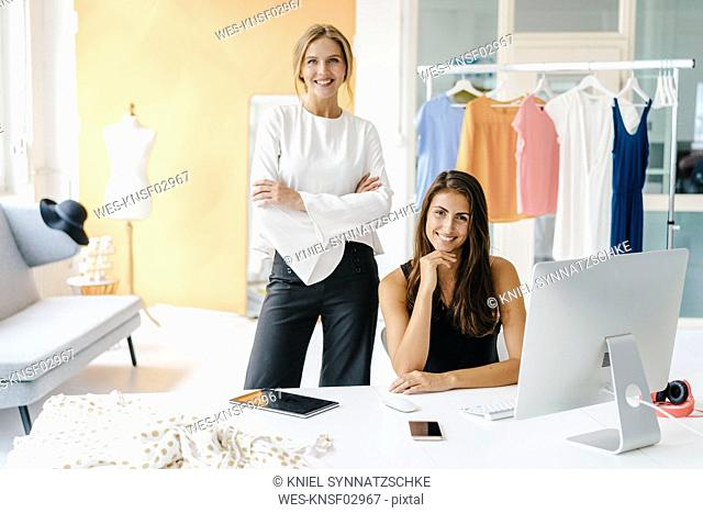 Portrait of two confident young women in fashion studio