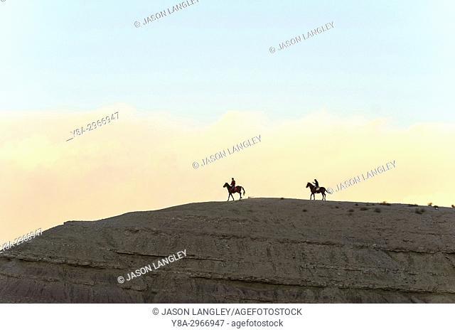 Morocco, Sous-Massa (Sous-Massa-Draa), Ouarzazate Province. People on horseback near Ait Ben Haddou (Ait Benhaddou)