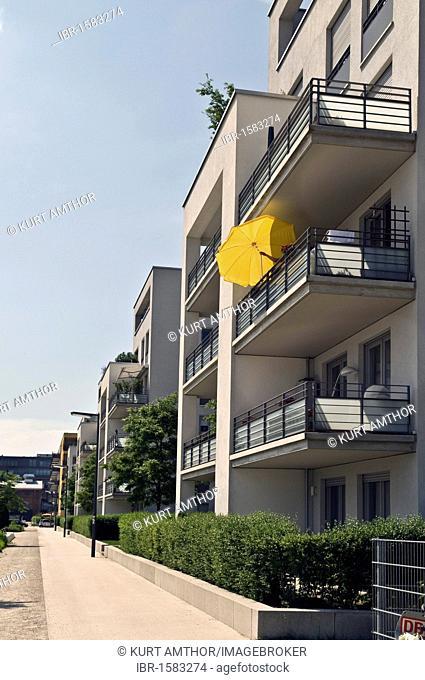 Modern residential houses, yellow parasol, Am Arnulfpark district housing development, Munich, Bavaria, Germany, Europe