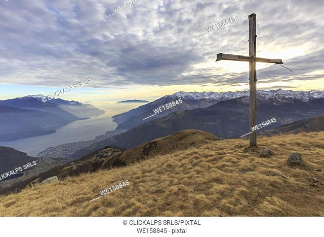 The Bodone cross at sunset, in the background Como lake, Lombardy, Italy, provence of Como
