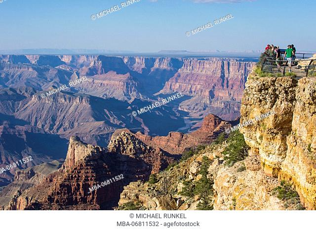 Tourists standing on a plattform on the desert view point over the Grand Canyon, Arizona, USA