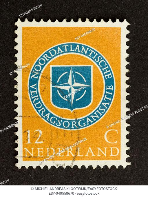 HOLLAND - CIRCA 1950: Stamp printed in the Netherlands shows the symbol of the Northatlantic Treaty Organisation, circa 1950