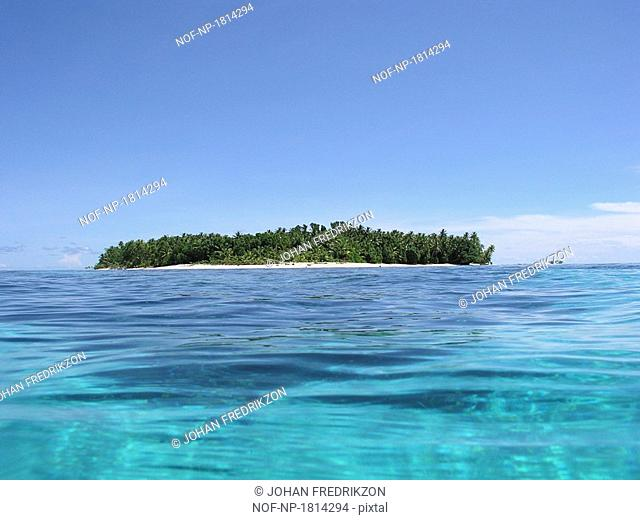 Island at the waterfront and green water, Tepuka, Tuvalu