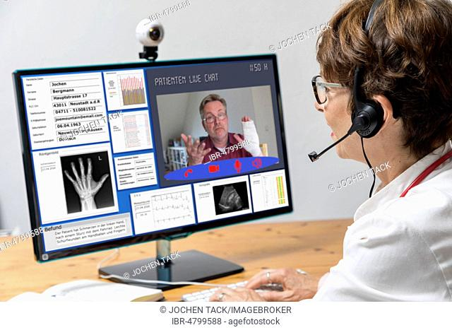 Symbol photo for telemedicine, doctor in a practice, communicates with the patient via a webcam, patient data and findings on the monitor, Germany