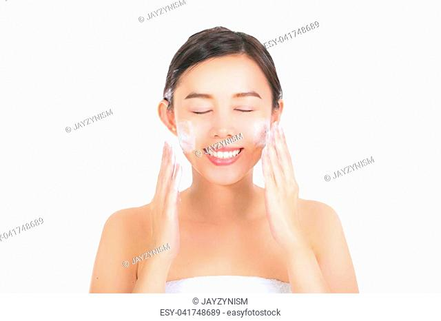 Close up of beautiful young woman with cleansing foam for skin care. with clipping path