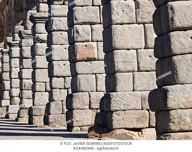 Arches and pillars built with granite blocks without mortar in the Roman aqueduct of Segovia - Castilla-León - Spain