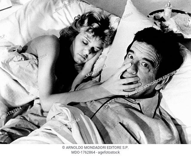 Walter Matthau and Denise Galik in California Suite. American actress Denise Galik sleeping with her hand on the face of American actor Walter Matthau (Walter...