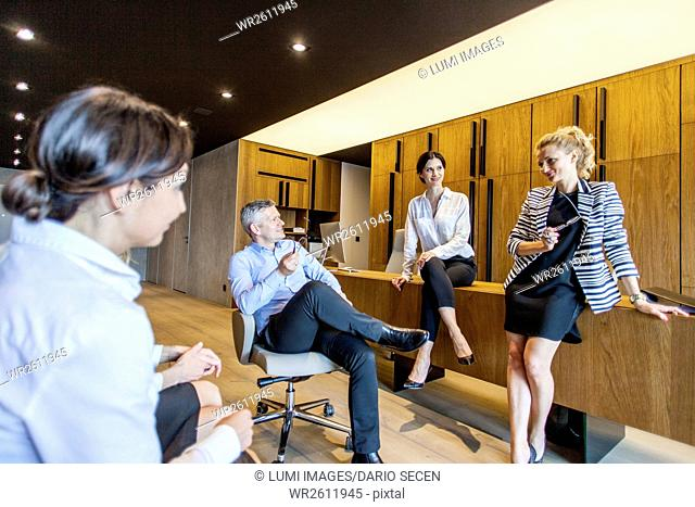 Group of business people talking in lobby