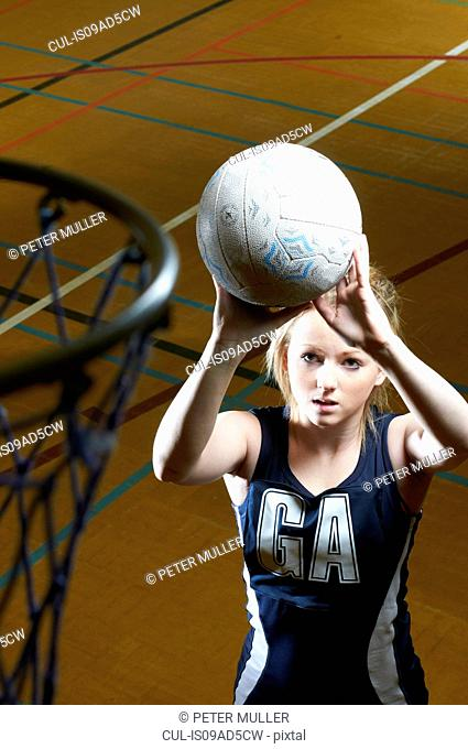 Netball player aiming at goal