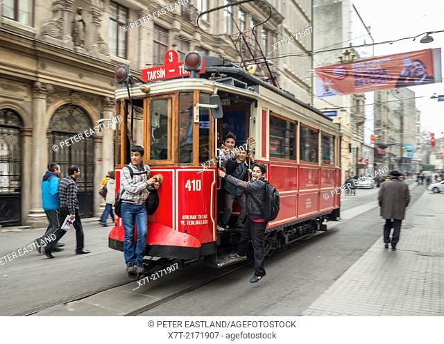 Kids playing on a tram in Istiklal Caddesi, Beyoglu, Istanbul, Turkey,