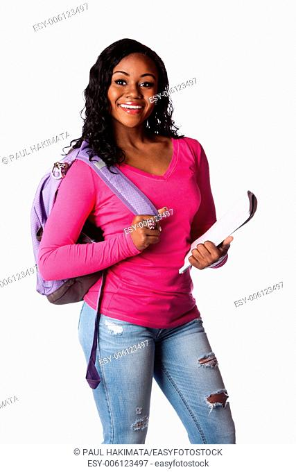 Happy smiling female highschool college student standing with backpack and notepad, isolated