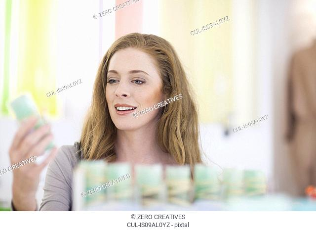 Woman browsing products on display shelf