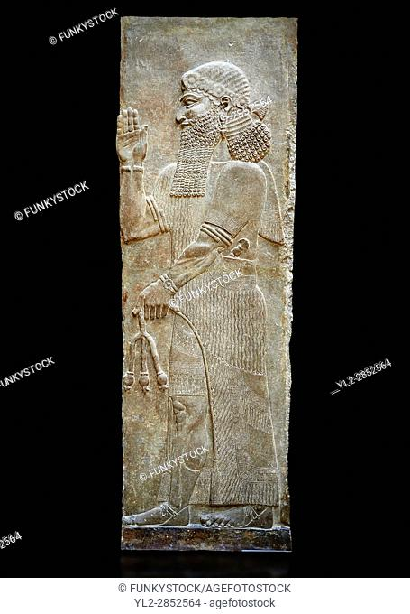 Stone relief sculptured panel of a man holding poppy seed pods. Facade N. Inv AO 19870 from Dur Sharrukin the palace of Assyrian king Sargon II at Khorsabad