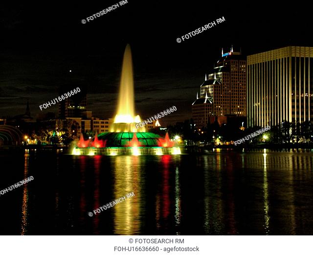 Orlando, FL, Florida, Lake Eola, colorfully lighted Clinton Allen Fountain, evening