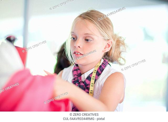 Girl playing fashion designer