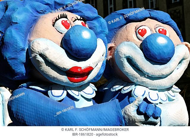 Funny clown pair, hand in hand, paper-mache figures, parade float at the Rosenmontagszug Carnival Parade 2011, Duesseldorf, North Rhine-Westphalia, Germany