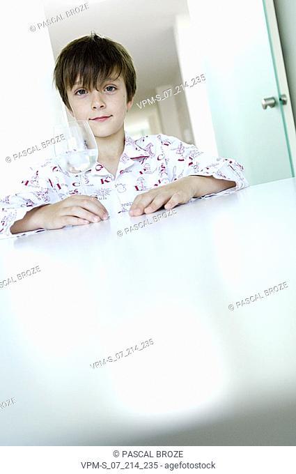 Portrait of a boy holding a glass
