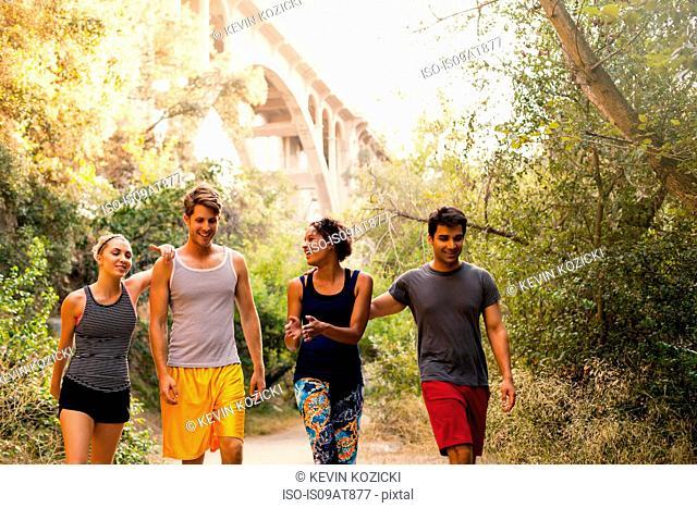 Joggers walking and chatting, Arroyo Seco Park, Pasadena, California, USA