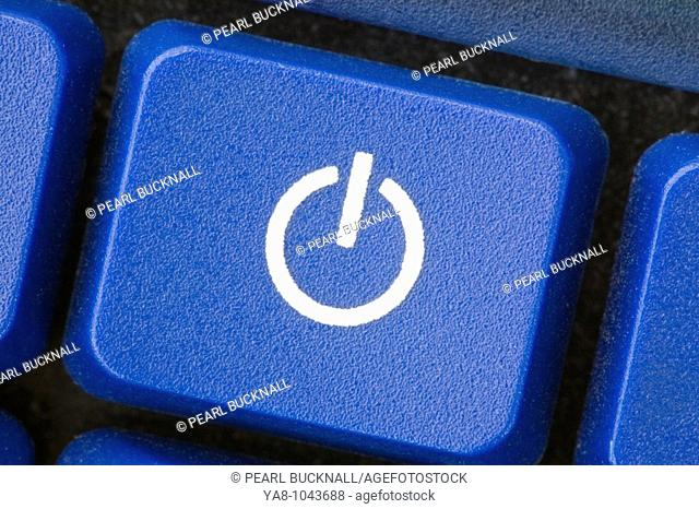 Close-up of a white power switch symbol on blue key