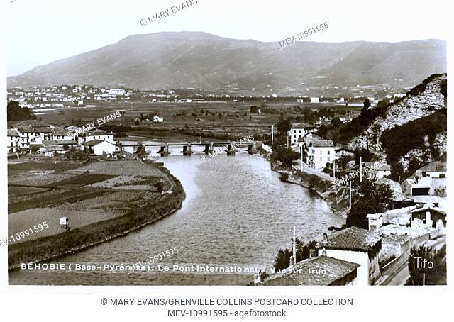 Behobie, Pyrenees-Atlantiques, Aquitaine, France - The International Bridge over the River Bidassoa and view toward Pyrennes Mountains