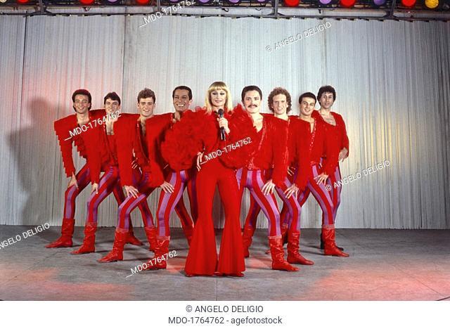Raffaella Carrà with her ballet company. Italian showgirl Raffaella Carrà (Raffaella Maria Roberta Pelloni) posing with her ballet company. 1983