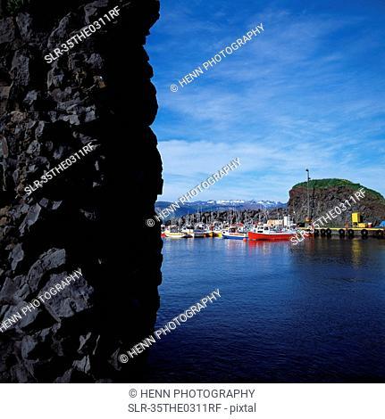 Rock wall and urban bay